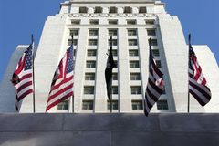 City Hall with Flags. US flags adorn los angeles city hall Stock Images