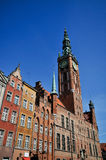 City Hall of Gdansk. Historical buildings in Old town of Gdansk on Dluga street with City hall above them Royalty Free Stock Photos
