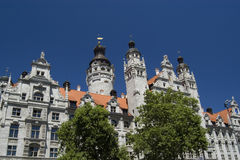 City Hall of Leipzig. Leipzig town hall with towers and dome with deep blue sky and two trees in the foreground Royalty Free Stock Photo