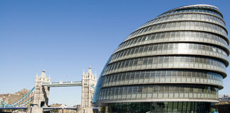 City Hall, London. View of the offices of the London Mayor and London Assembly, on the south bank of the Thames in Southwark.  Tower Bridge is behind Royalty Free Stock Photo