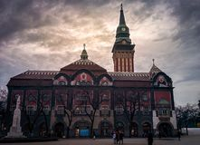 City Hall with monument at sunset in Subotica stock photography