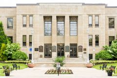 City hall of st catharines ontario canada. City hall municipal building of st catharines ontario canada front view park chairs lawn grass entrance stock images