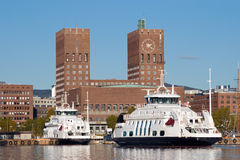 City Hall of Oslo, Norway. The City hall of Oslo, Norway, with local ferries at the pier in the foreground stock image