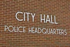 City Hall & Police Headquarters. Simple City Hall & Police Headquarters Sign Against Brick Background stock image