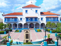 City hall in SANTIAGO de CUBA. Town with beauty colorful square and cloudy blue sky in 2017 warm sunny spring day, NORTH AMERICA on MARCH Royalty Free Stock Photography
