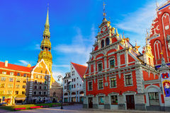 City Hall Square in the Old Town of Riga, Latvia. City Hall Square with House of the Blackheads and Saint Peter church in Old Town of Riga in the evening, Latvia Royalty Free Stock Photo