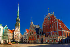 City Hall Square in the Old Town of Riga, Latvia. City Hall Square with House of the Blackheads, Saint Roland Statue and Saint Peter church in Old Town of Riga Stock Photography