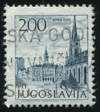City hall square. RUSSIA KALININGRAD,12 NOVEMBER 2016: stamp printed by Yugoslavia, shows the cathedral and city hall square, circa 1971 Royalty Free Stock Photos
