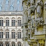 City Hall and St. Peter& x27;s Church in Leuven. Leuven is the capital of the province of Flemish Brabant in Belgium.  View on a street with city hall and St Royalty Free Stock Image