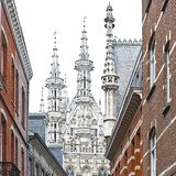 City Hall and St. Peter& x27;s Church in Leuven. Leuven is the capital of the province of Flemish Brabant in Belgium.  View on a street with city hall and St Royalty Free Stock Photos