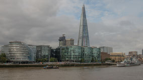 City Hall to the Shard. View from Tower Bridge, London, of the South Bank of the River Thames, from City Hall on the left to the Shard of Glass seeming to pierce Royalty Free Stock Photo