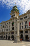 City Hall, Trieste. Perspective of the Palazzo Comunale (City Hall) in Trieste, with a beautiful clock tower and two bronze statues Royalty Free Stock Photo