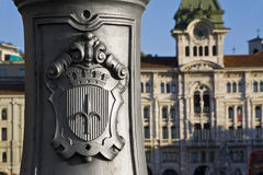 City Hall of Trieste. Detail of a lamp with the background the town hall in Trieste Royalty Free Stock Images