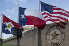 City hall and waving  flags in Dallas TX. City hall  and waving Texas state ,America and city flags in Dallas ,TX USA Royalty Free Stock Photography