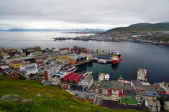 City of Hammerfest, Norway. The northmost city in the world - center of a scandinavian town of Hammerfest visible from a hill, with a seaport in the middle, and Stock Photo