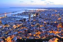 City and harbor of Alicante at dusk royalty free stock photos