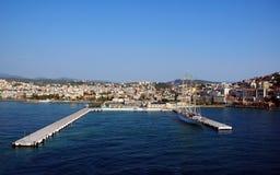 City and harbor at Kusadasi-bird island. City and harbor at Kusadasi, bird island on the turkish coast of the mediterranean sea Royalty Free Stock Image