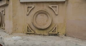 stucco on the wall of a low house in the old part of the city stock photos