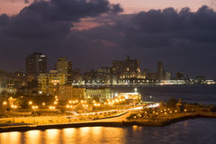 The city of Havana illuminated at night. With a view of the caribbean sea Royalty Free Stock Images