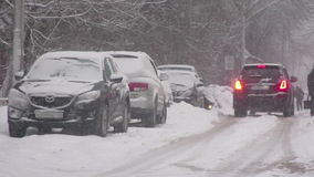 While city heavy snow storm. Traffic driving along freeway during heavy snow storm stock footage