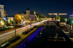 The city of Helmond at night time. The city of Helmond, with the canal called Zuid Willemsvaart that runs right through the centrum. The old bridge is a monument stock image