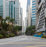 City high-rise buildings and roads on background. Royalty Free Stock Image