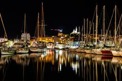 City With High Rise Buildings and Sea at Night Time Stock Photography