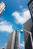 City high-rise buildings and the surveillance camera Royalty Free Stock Photo