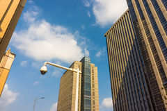 City high-rise buildings and the surveillance camera Stock Images