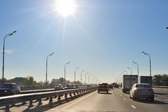 City highway. With moving cars in bright morning stock photos
