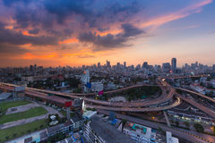 City highway interchanged with central business downtown backgroundAerial view Bangkok city background and highway intersection wi Stock Photography