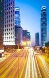 City highway light trails of modern landmark buildings backgroun Royalty Free Stock Photos