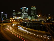 City highway at night. Streaks of vehicle lights on a busy city highway in the Docklands, London, UK Stock Photos