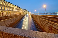 City highway for road transport. The view at night.The road passes under the bridge Royalty Free Stock Photo