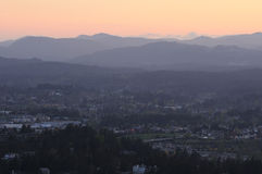 City and hills in dusk Stock Photos