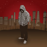 City Hoody. Silhouette with slight detail of man in cityscape Royalty Free Stock Images