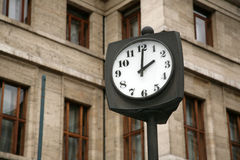 City hours. On a background of the house Royalty Free Stock Images