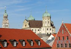 City house of Augsburg. Over the roofs you see the town hall of Augsburg in Germany and a church tower on the left side royalty free stock images