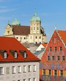 City house of Augsburg. Over the roofs you see the town hall of Augsburg in Germany stock photography