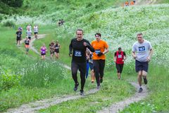 City Ikscile, Latvian Republic. Courage race, people were engaged in sports activities. Overcoming various obstacles and running. stock photo