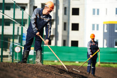 City improvement, landscaping and urban beautification. Two municipal construction workers making urban improvement, landscaping and beautification royalty free stock image