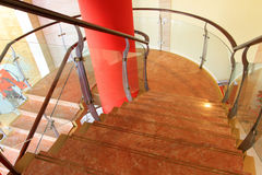 City indoor glass rotary stairs royalty free stock photos