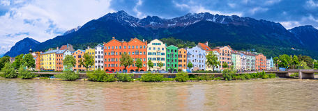 City of Innsbruck colorful Inn river waterfront panorama. Tyrol state of Austria stock photography