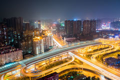 City interchange at night. Wuhan cityscape with urban traffic background, China Royalty Free Stock Photo
