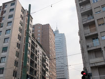 City Intersection and High Rise Buildings. Low Angle Architectural View of High Rise Buildings in Urban Environment, as seen from Intersection with Red Stop Royalty Free Stock Photos