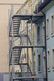 City iron staircase near the wall of a multistory building Stock Photo