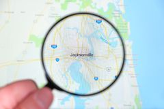 City of Jacksonville, Florida on the display screen through a magnifying glass royalty free stock photography