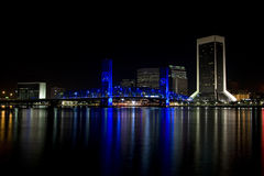 City of Jacksonville, Florida at night. Night scene of the city of Jacksonville, Florida at night with lights from the main street bridge and all the buildings Royalty Free Stock Photography