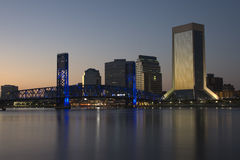City of Jacksonville, Florida at night. Night scene of the city of Jacksonville, Florida at night with lights from the main street bridge and all the buildings Stock Photos
