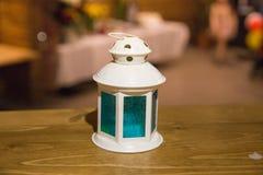 Candle. Blue glass and retro lamp style. City Jekabpils, Latvia. Retro style candle. Home design. Travel photo 2018 Royalty Free Stock Photos
